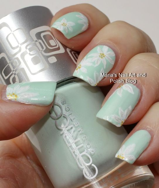 Subtle floral nail art on pastel mint (204062)