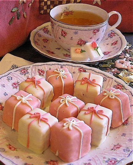Pretty teacup and cute little parcel cakes | We Heart It | tea, cake, and pink (456724)
