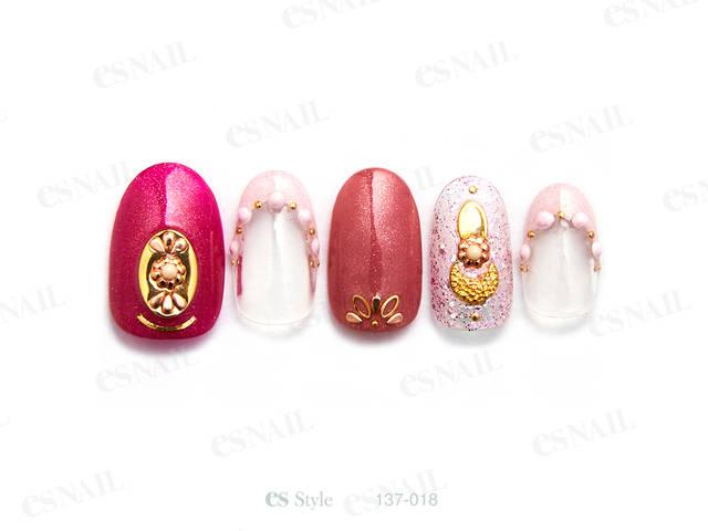 ラメ感のある色味違いのピンクにピンクとゴールドのパーツ...